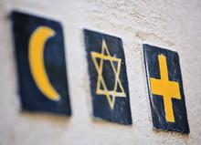 Set Of 3 Religious Symbols: Islamic Crescent, Jewish David's Star, Christian Cross (wall Sign On The Street Of Segovia, Spain)