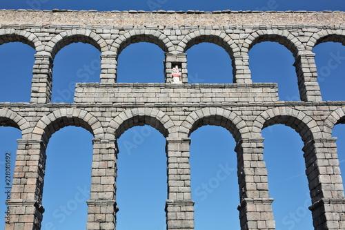 Fotografie, Obraz Ancient Roman aqueduct bridge of Segovia, Castilla Leon, Spain