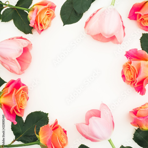 Fotobehang Bloemen Floral frame of roses and tulip flowers and leaves on white background. Flat lay, top view