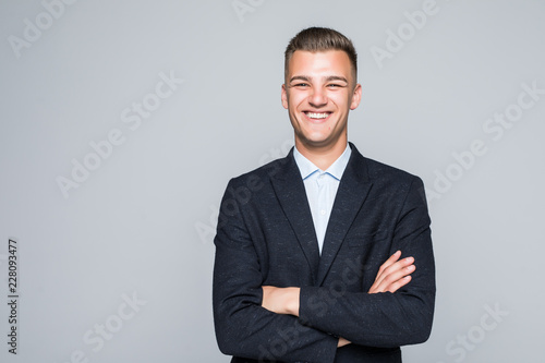 Fototapeta Portrait of businessman with crossed hands, isolated on white background. Concept of leadership and success obraz na płótnie