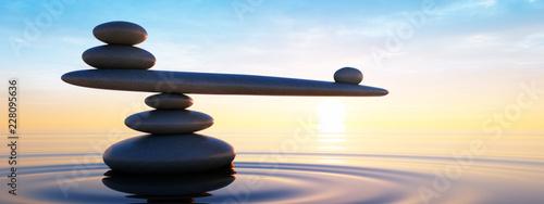 Fotografia Steine in Balance - Gleichgewicht bei Sonnenaufgang im Meer
