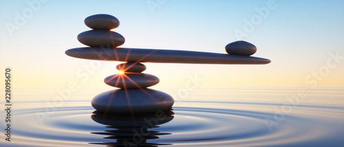 Valokuva Steine in Balance - Gleichgewicht bei Sonnenaufgang im Meer