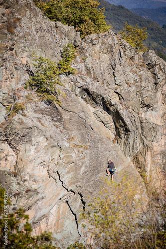 Foto op Plexiglas Alpinisme male climber working hard to lead up a rock wall