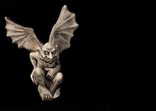 Gargoyle With Wings On Black Background