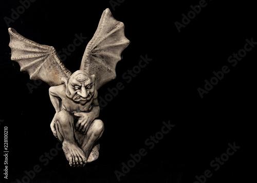 Slika na platnu gargoyle with wings on black background