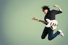 Portrait Of A Musician Jumping...