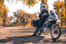 Motorbiker Travelling, Autumn Day, Motorcycle Off Road, Rider, Adventurer, Extreme Tourism, Cold Weather Clothes, Yellow Forest, Copy Space, Uses Smartphone, Internet, Search,