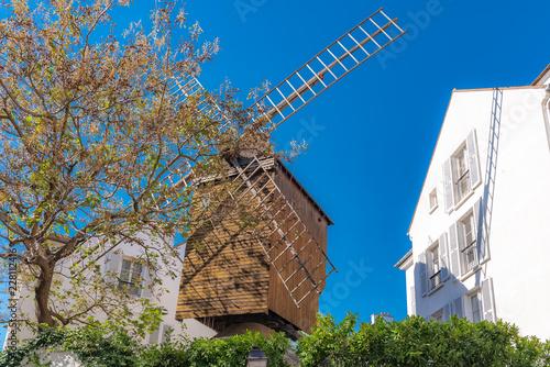 Fototapety, obrazy: Montmartre, the windmill «Moulin de la Galette», famous touristic place in Paris