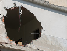 Huge Hole With Wires Hanging I...