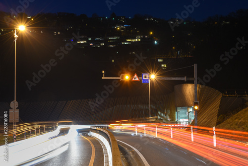 The car light trails in front of a tunnel at Lugano