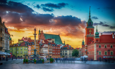 Panoramic view on Royal Castle, ancient townhouses and Sigismund's Column in Old town in Warsaw, Poland. Evening view.