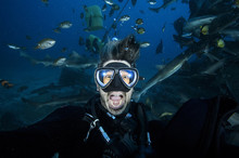 Pancking And Scared Scuba Diver Underwater With Mouth Wide Open