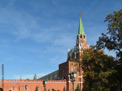 Moscow Kremlin against blue sky in autumn. Troitskaya tower, russian symbol on Red Square