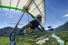 Selfie Shot Of Brave Extreme Hang Glider Pilot Soaring The Thermal Updrafts Above Alpine Valley
