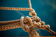 Rope With Knot On Wooden Backg...