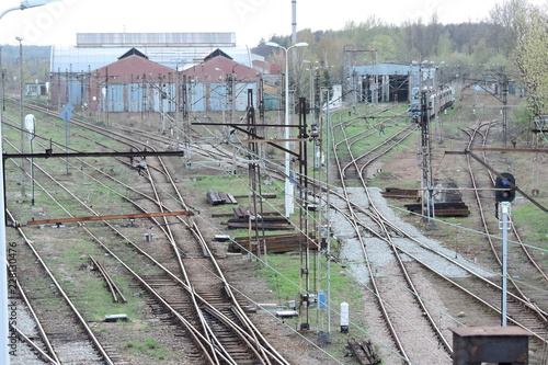 Fototapeta Railway tracks and some buildings where trains are repaired obraz