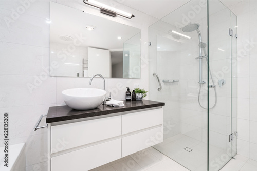 Fotografie, Obraz  Large modern bathroom interior with floor to ceiling tiling and luxury fittings