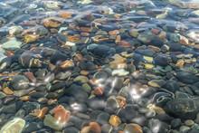 Pebble Under Water On Red Beach, Santorini, Greece.