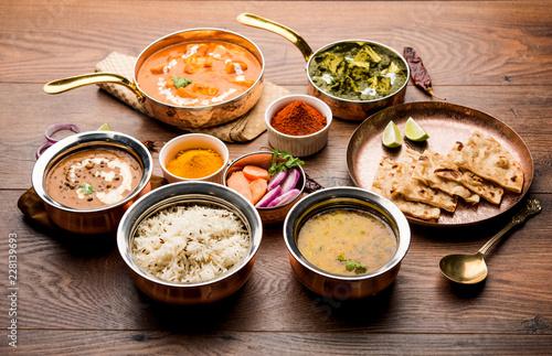 Fényképezés  Indian Lunch / Dinner main course food in group includes Paneer Butter Masala, D