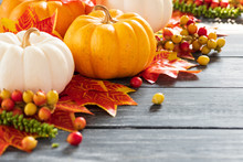 Autumn Maple Leaves And Pumpkin On Old Wooden Backgound. Thanksgiving Day Concept.