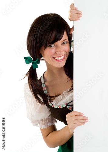 Fotografie, Obraz  Smiling St Patrick's Oktoberfest Girl Holding A Blank Sign Copy Space