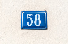 Old Vintage House Address Blue Metal Plate Number 58 Fifty Eight On The Plaster Facade Of Abandoned Home Exterior Wall On The Street Side
