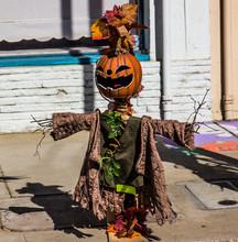 Halloween Scarecrow On  Sidewalk