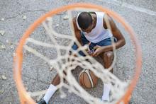 Man With Basketball Using Smar...