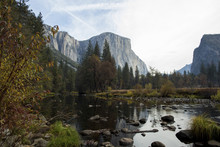 Scenic View Of Lake And Mountains In Forest At Yosemite National Park