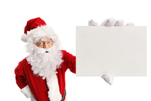 Surprised Santa Claus Holding A Blank Card