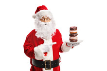 Santa Claus Holding A Plate Of...