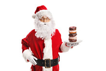 Santa Claus Holding A Plate Of Donuts