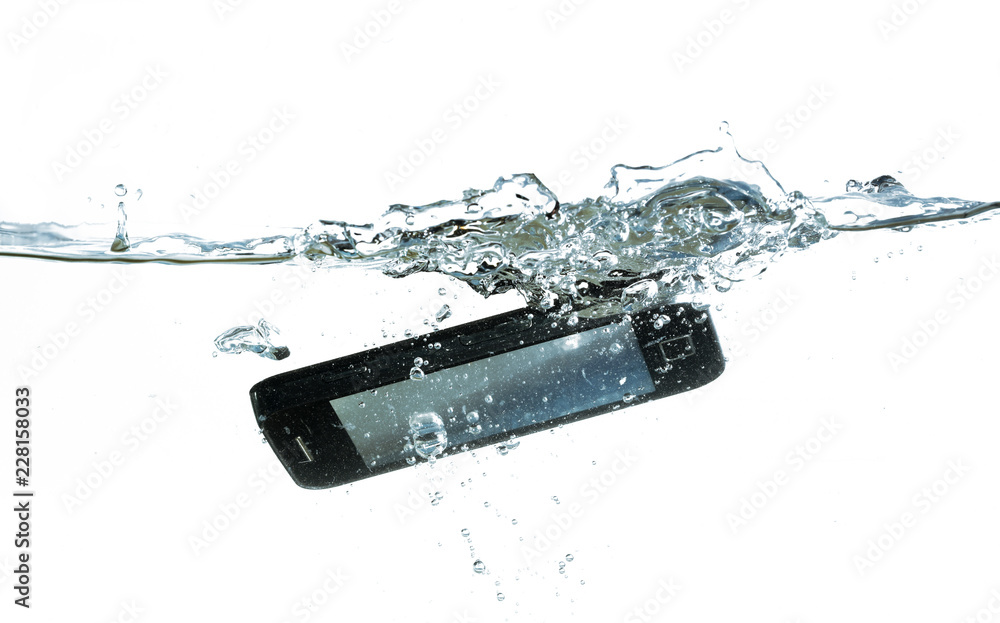 Fototapeta smartphone is falling into the water with splash, concept for waterproof product or insurance claim, isolated on a white background, copy space