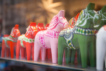 Dala on sales in a tourist shop in Stockholm, Sweeden. Dala is a traditional carved and painted wooden horse statuette symbol of Sweden.