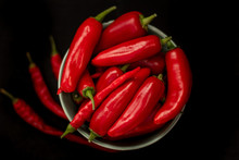 Red Chili Peppers In A Plate On A Dark Background, Top View