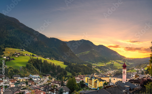 Sunset over Ortisei St Ulrich, Dolomites Alps mountains, Italy. Canvas Print