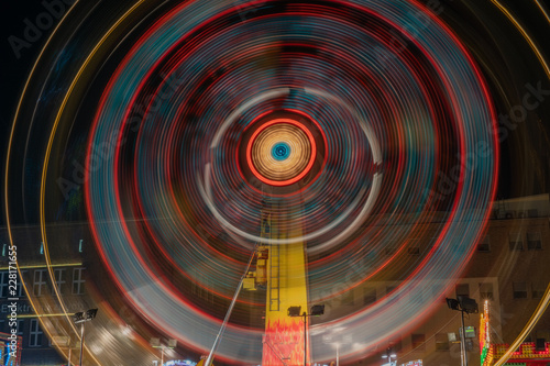 Photographie  Illuminated carousel at night. Bytom
