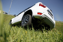 Rollover Compact Car Crash. White Crashed Car In The Mountain Road Ditch In California, USA. Traffic Accident.