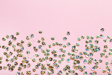Round Colorful Sequins On Pink Background