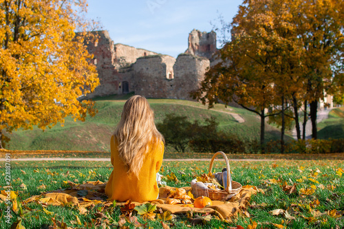 Woman Sitting Plaid Basket with Food Bakery Autumn Picnic Time Rest Background Old Ruins Background