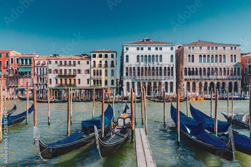 Fotobehang Venetie Gondolas and Venetian houses by the Grand Canal of Venice, Italy