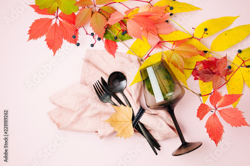 Fotografía  Festive table setting with Bright Autumn leaves on pastel background