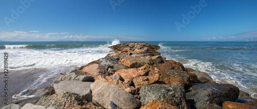 Spoed Foto op Canvas Verenigde Staten Ventura sea rock wall jetty on the California coastline USA