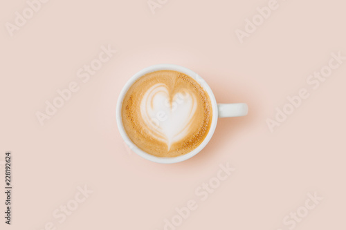 Coffee cup on pale pink background. Flat lay, top view Fototapete