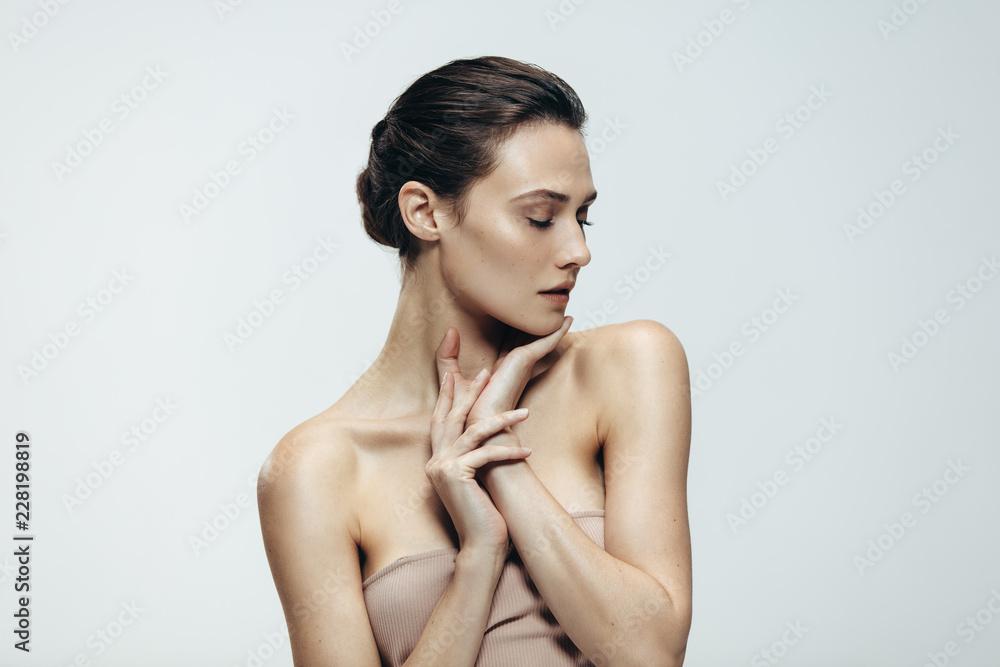 Fototapeta Young woman with glowing skin