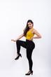 Full body shot of young beautiful Indian woman posing