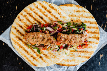 Fototapeta grilled kebab with salad