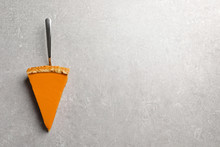 Piece Of Fresh Delicious Homemade Pumpkin Pie On Gray Background, Top View With Space For Text