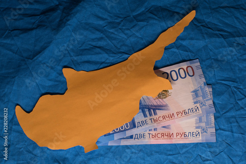 Foto op Canvas Cyprus New russian 2000 rubles banknotes under cutted out of paper Cyprus island
