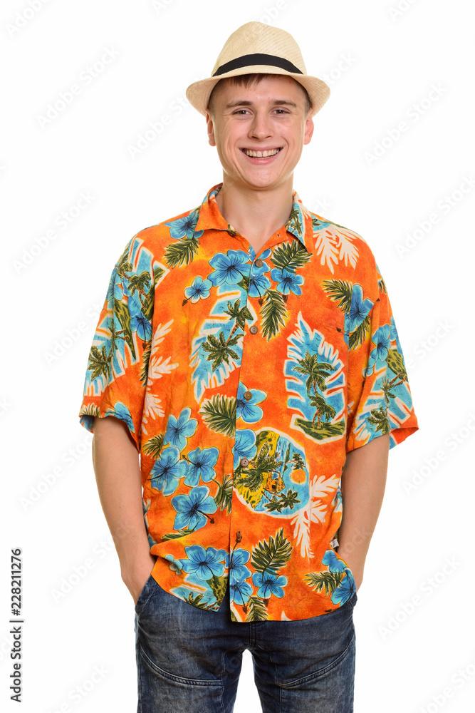 Fototapeta Young happy Caucasian tourist man smiling and wearing hawaiian shirt